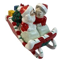 Lipper and Mann Kissing Santa and Mrs Claus Salt and Pepper Shakers in Sleigh with Presents Vintage Japan Christmas