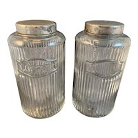Two Raised Ribbed Hoosier Jars