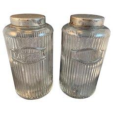 Two Raised Ribbed Hoosier Jars