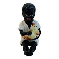 Bisque Boy Holding a Chicken