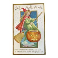 Stecher Litho Co Halloween Postcard Embossed Witch in Red Cloak Green Dress Broom JOL Jack O Lantern 226 C