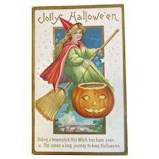 Stecher Litho Co Halloween Postcard Embossed Witch in Red Cloak Green Dress Broom JOL Jack O Lantern 226 C