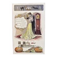 1907 Unused Lounsbury Halloween Postcard Romantic Poem with Couple Clock Strikes Twelve Bats Black Cat Edwardian Era Embossed