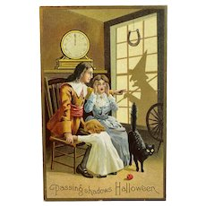 Halloween Postcard Passing Shadows Colonial Couple Witch Shadow Black Cat Horseshoe Clock at Midnight Embossed