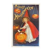 1910 Signed Clapsaddle Halloween Postcard International Art Publishing Co Witch Girl in Red Stirring Brew Pumpkin JOL Jack O Lantern 978