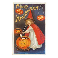 1910 Signed Clapsaddle Halloween Postcard International Art Publishing Co Witch Girl in Red Stirring Brew Pumpkin JOL Jack O Lantern 978