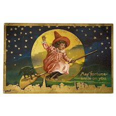 1910 Jolly Halloween Postcard Girl in Red Witch Hat Flying Past the Moon with Black Cat on Broom Embossed