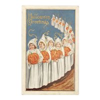 1917 Halloween Postcard Girls in Ghost Costumes Carrying JOLs Jack O Lanterns Embossed Pumpkins
