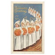 1917 Halloween Postcard Girls in Ghost Costumes Carrying JOLs Jack O Lanterns Embossed Pumpkins