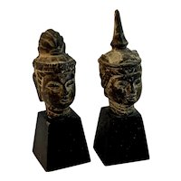 Two Buddha Metal Busts on Wood Pedestals