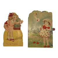 2 German Mechanical Valentines Cupid and Girl Holding Card Germany