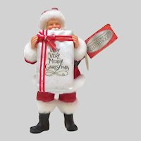Enesco Limited Edition Clothique Santa Holding Gift