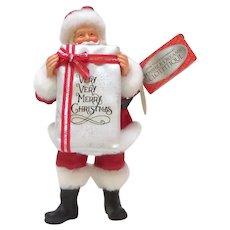 Enesco Limited Edition Clothique Santa Holding Gift