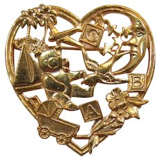 Heart Shaped Brooch with Baby and Travel Motif