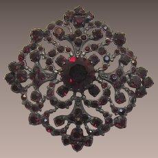 Austria Gunmetal and Deep Ruby Red Rhinestone Victorian Revival Brooch