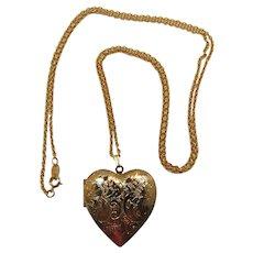 Avon Large Gold-tone Heart Locket