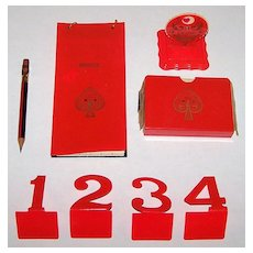 """Celluloid Auction Bridge Set w/ Standard """"Aviator"""" Playing Cards, Card Holder, Covered Score Pad, Trump Indicator, Table Numbers (1-4), Eagle Pencil, c.1929"""