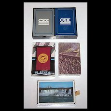 """4 Sets Railroad Playing Cards, Various Prices $5-$10/ea.: (i) Double Deck Whitman """"CSX,"""" c.1994, $10; (ii) USPC """"New York Central,"""" c.1958, $10; (iii) Maker Unknown """"Algoma Central"""" c.1990, $5; (iv) Hoyle """"Denver & Rio Grande Western"""" c.1988, $5"""