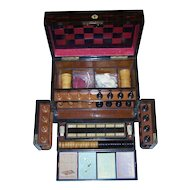 Victorian Walnut Games Compendium w/ Leather Game Board, Staunton-Type Chess Set, Checkers, Cribbage Board. Dominoes, Bezique Cards (2) and Markers, Whist Cards (2), Dice, Chips and Dice Cups, c.1870