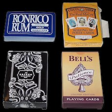 """4 Decks Alcoholic Beverages Advertising Playing Cards, $10/ea.: (i) """"Ronrico Rum,"""" Maker Unknown; (ii) USPC """"Cutty Sark – The Real McCoy,"""" c.1994; (iii) """"Kraken Rum,"""" Maker Unknown; and (iv) Carta Mundi """"Bell's,"""" 2006"""