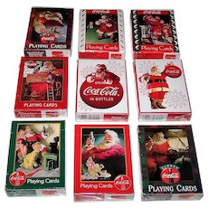 "9 Decks USPC ""Coca Cola Christmas Santa Claus"" Playing Cards, $3/ea."