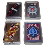 "4 Decks Clear, Invisible Plastic Playing Cards, $10/ea.: (i) Coca-Cola Advertising; (ii) Kikkerland ""Invisible Cards,"" Pieter Woudt Designs; (iii) ""Disneyland – Walt Disney World""; and (iv) USPC ""Bicycle"""
