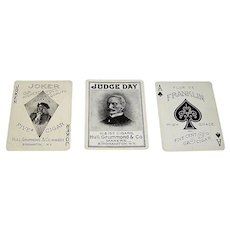 "3 SINGLES, USPC ""Flor de Franklin 5¢ Cigars"" Advertising Playing Cards, Hull, Grummond & Company, $5/ea.:  (i) Joker; (ii) Judge Day Extra Card; (iii) Ace of Spades, c.1910"