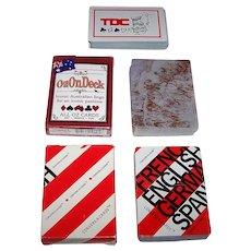 "3 Decks Verbal Aid Playing Cards, $10/ea.: (i) TDC, Inc. ""Travel Face"", c.1975 (French/Spanish/English); (ii) Bonny ""Convers-A-Cards"" (French/German/English); (iii) All Oz Cards ""OzOnDeck"" (Australianisms)"