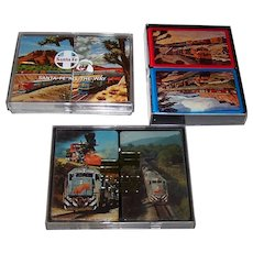 "3 Double Decks Railroad Cards, $20/ea.: (i) Brown & Bigelow (Stancraft) ""Santa Fe"", c.1968; USPC (Liberty) ""Santa Fe"", c.1972; and (iii) Gemaco ""Seabord Coast Line"" c.1982"