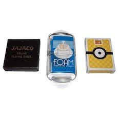 "3 Decks Novelty Playing Cards, $15/ea.: (i) Ace ""Jajaco"" Round, ""Star Trek"" Cards, c.1962; (ii) Starbucks Caffe Latte ""Foam"" Oblong, Maker Unknown; and (iii) McDonald's ""Despicable Me 3"" Wide Oblong, Maker Unknown"