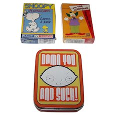 "3 Decks Animation  Playing Cards, $5/ea.: (i) Hoyle ""Snoopy""; (ii) ""The Simpsons""; (iii) ""Family Guy -- Damn You and Such"""