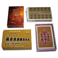 "4 Decks China Playing Cards, $10/ea.: (i) Dongba Pictographic Glyphs, Maker Unknown; (ii) ""Subterranean Army of Emperor Qin Shi Huang (""Terracotta Army""), Maker Unknown; (iii) AAA ""Masks""; and (iv) AAA ""Artworks/Implements"""