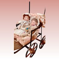 Delightful Babies in Antique Carriage