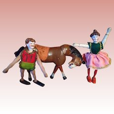 Two American Bisque headed Circus Acrobats with their Schoenhut horse.