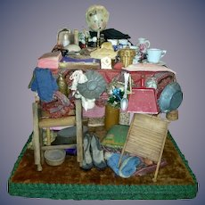 Antique Wooden Sitting Peddler with her table full of wares