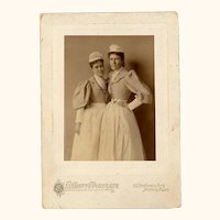 Interesting Early Sepia Photograph of Two Nurses Wearing Black Ribbon Guard Chains with Watch, USA