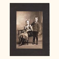 Cabinet Card of Two Siblings Dressed up For the Photographer, Late 19th Century, American