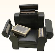 20th Century Games Compendium in the form of a Leather arm chair