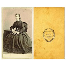 Sepia CDV of Civil War-Era Lady wearing American-style Chatelaine, Holding a Book
