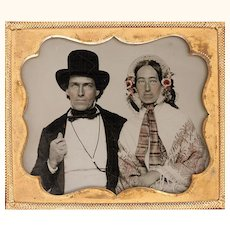 Hand-coloured Ambrotype of Couple with Extraordinary Hats, Gentleman with Cord Watch Guard Chain, c1840s
