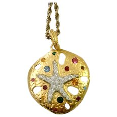 Glitzy, Golden Sand Dollar Pendant Necklace: Kenneth Jay Lane KJL