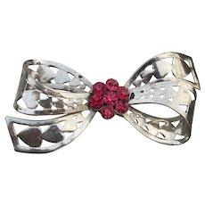 Retro 1940's Pink Rhinestone Aluminum Open Work Heart Bow Pin