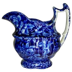 Dark Blue Staffordshire Creamer: Cupid in Jail, c. 1820