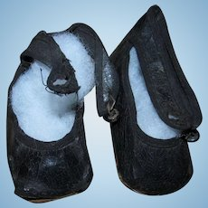 Antique Black Oilcloth Doll Shoes with Shoe Buttons show wear