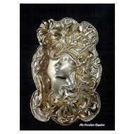 Art Nouveau heavily embossed lady and flowers brass card or trinket tray