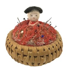 Vintage Japanese Composition Doll in a Basket Pin Cushion