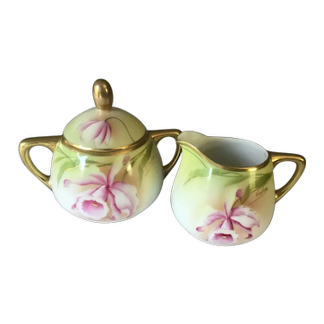 Royal Rudolstadt Prussia Cream Pitcher and Sugar Bowl Cattleya Orchids Artist Signed
