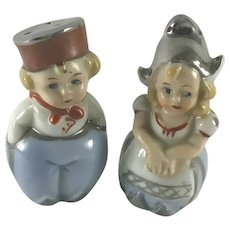 Vintage Silver Top Porcelain Dutch Couple Salt and Pepper Shakers