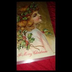 Rosy Cheeks Angel Child With Holly Berries & Leaves in Wavy Hair Christmas Embossed Postcard - Red Tag Sale Item