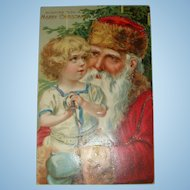 Early 1900's German Embossed Santa and Child Postcard Unsigned Brundage Blue Green Mittens